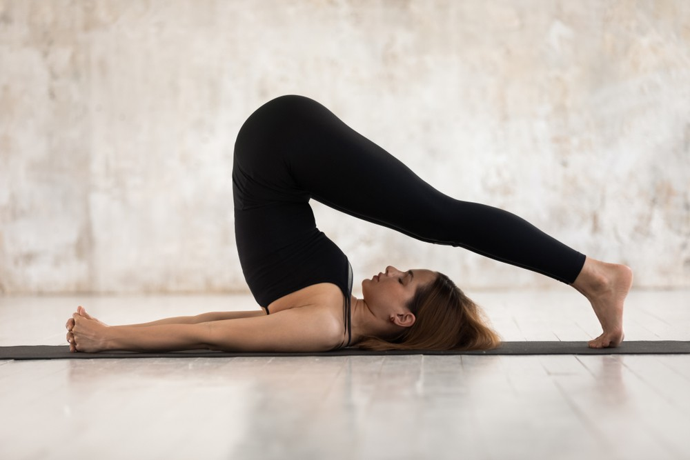 plow-pose-yoga-positions.jpg