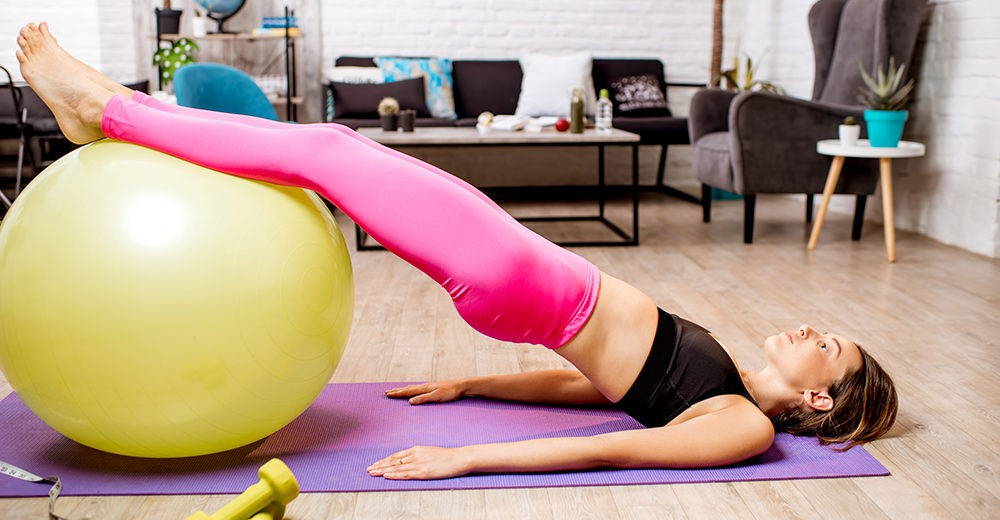 woman-exercising-with-fitball-1000x520.jpg